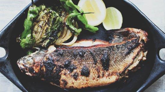 Whole roasted branzino recipes purewow for Branzino fish recipes