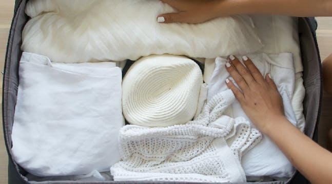 A Brilliant Trick for Packing a Floppy Hat in a Suitcase
