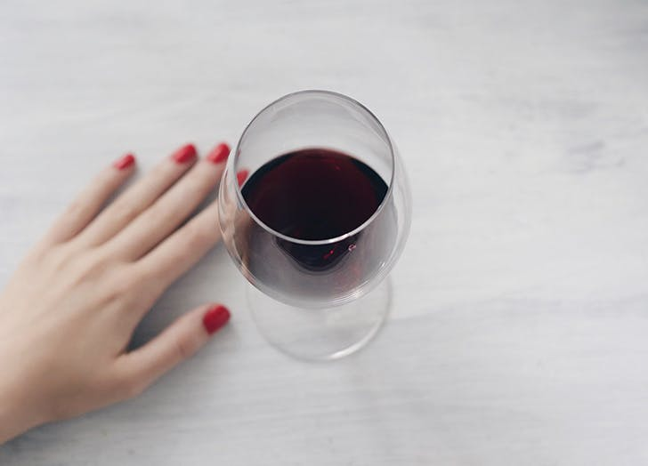 bartender drinks wine