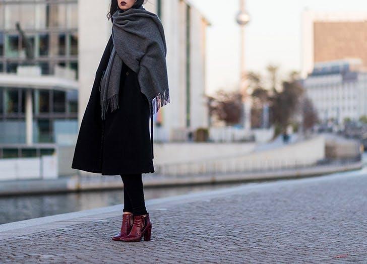 black coat gray scarf burgundy boots